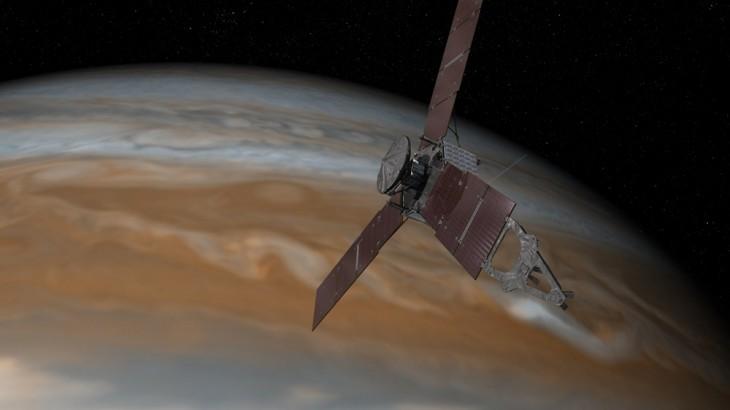 Wizja artystyczna przedstawiająca sondę Juno na tle Jowisza