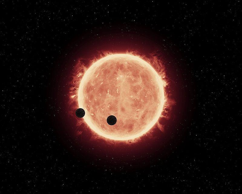 Tranzyt planet na tle TRAPPIST-1 (wizja artysty).