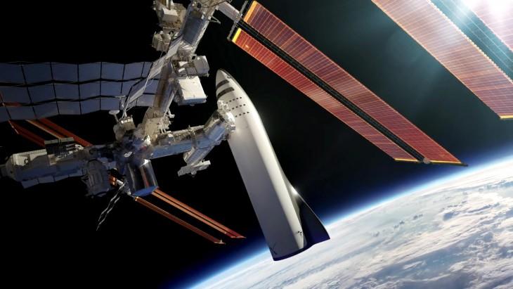 """Choć Międzynarodowa Stacja Kosmiczna wygląda przy Big Falcon Rocket dosyć niepozornie, anawet wręcz komicznie, Musk zapewnił – """"To będzie działać""""."""