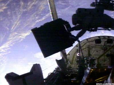 Jim Newman trzyma FOC Hubble'a