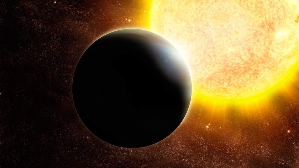 Wizja artystyczna egzoplanety wielkości Jowisza i jej gwiazdy o masie odrobinę większej od masy Słońca.